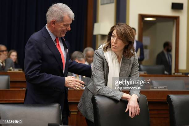 Wells Fargo and Company CEO Timothy Sloan greets House Financial Services Committee member Rep Cindy Axne before Sloan testifies before the committee...