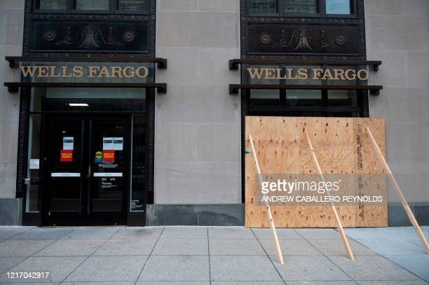 Wells Fargo Bank near the White House is boarded up, after the unrest from the past few nights, in downtown Washington, DC on June 2, 2020. -...