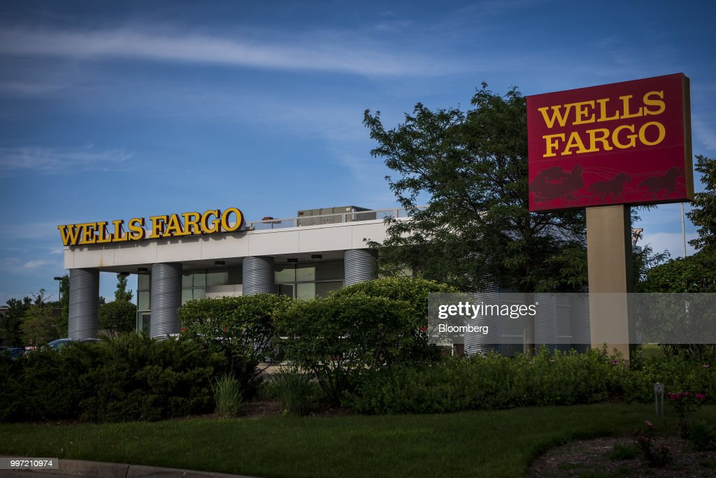 A Wells Fargo & Co. bank branch stands in Evanston, Illinois, U.S., on Tuesday, July 10, 2018. Wells Fargo & Co. is scheduled to release earnings figures on July 13. Photographer: Christopher Dilts/Bloomberg via Getty Images