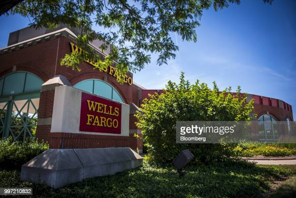 A Wells Fargo Co bank branch stands in Schaumburg Illinois US on Tuesday July 10 2018 Wells Fargo Co is scheduled to release earnings figures on July...