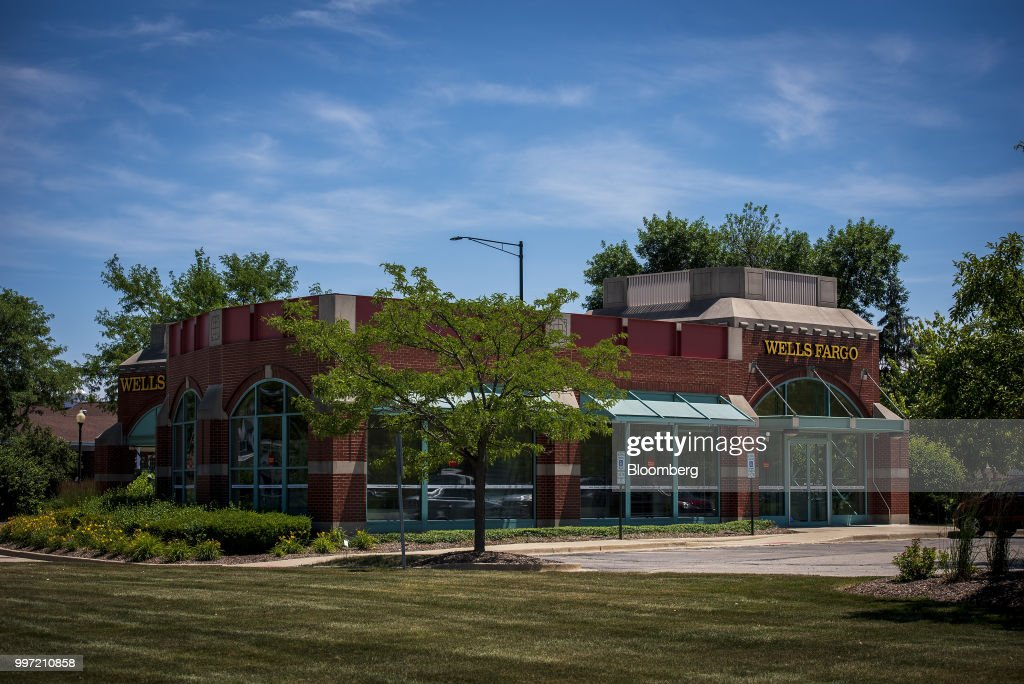 A Wells Fargo & Co. bank branch stands in Schaumburg, Illinois, U.S., on Tuesday, July 10, 2018. Wells Fargo & Co. is scheduled to release earnings figures on July 13. Photographer: Christopher Dilts/Bloomberg via Getty Images
