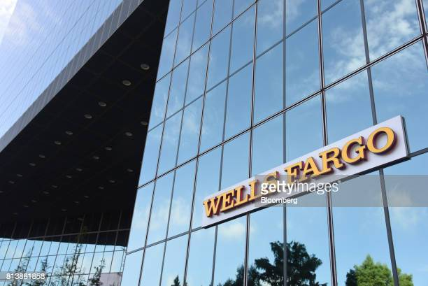 Wells Fargo Co signage is displayed on the exterior of a bank branch in Dallas Texas US on Monday July 10 2017 Wells Fargo Co is scheduled to release...