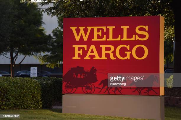 Wells Fargo Co signage is displayed outside a bank branch in Dallas Texas US on Monday July 10 2017 Wells Fargo Co is scheduled to release earnings...