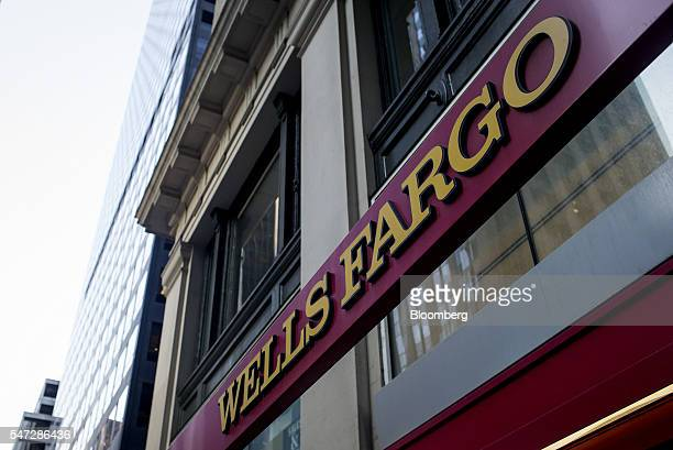Wells Fargo Co signage is displayed outside a bank branch in New York US on Tuesday July 12 2016 Wells Fargo Co is scheduled to release earnings...