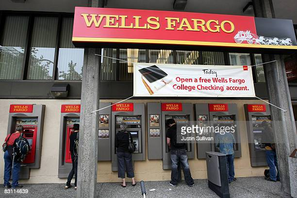 Wells Fargo customers use ATM machines outside of a Wells Fargo bank branch October 3 2008 in Berkeley California Four days after Citigroup had...