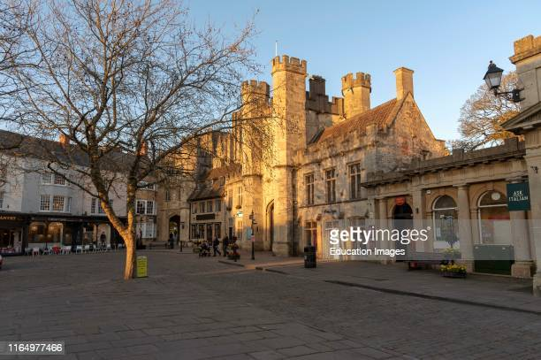 Wells Somerset England UK Glowing sun illuminates the Market Place and Bishops Eye Gatehouse in the cathedral city in the Mendip district of Somerset