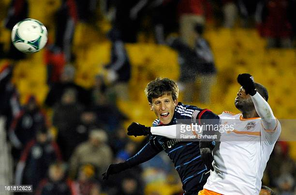 Wells Thompson of the Chicago Fire goes for a header against Chris Rolfe of the Houston Dynamo during the second half of their game in the Carolina...