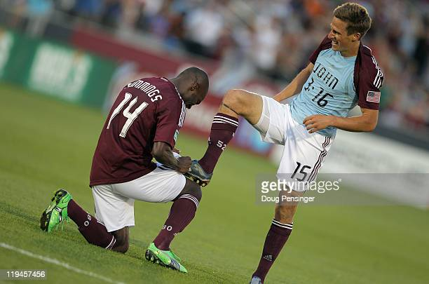 Wells Thompson of the Colorado Rapids has his boot polished by teammate Omar Cummings as they celebrate Thompson's goal against the New York Red...