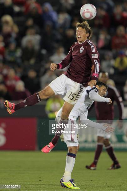 Wells Thompson of the Colorado Rapids heads the ball away from Javier Morales of the Real Salt Lake at Dick's Sporting Goods Park on October 14, 2011...