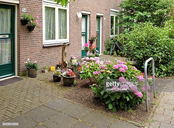 Welltended front yard with colorful flowers in Delft Holland