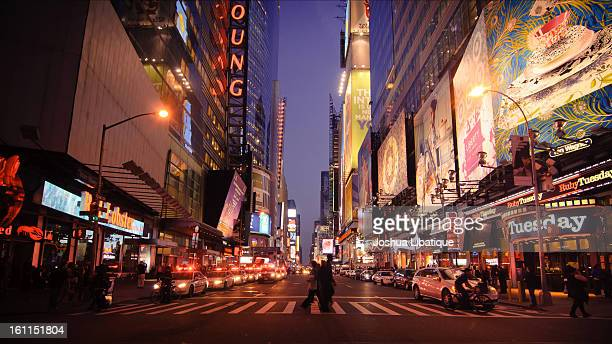 CONTENT] A welltimed shot in Times Square New York Just after sunset a rich purple and blue in the night sky Crossing pedestrians passing each other...