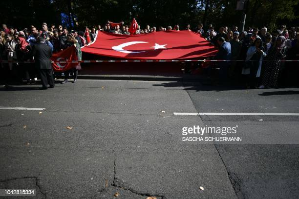 Wellwisher hold Turkish flags near Cologne's Central Mosque one of Europe's largest mosque prior to the visit of the Turkish President to Cologne...