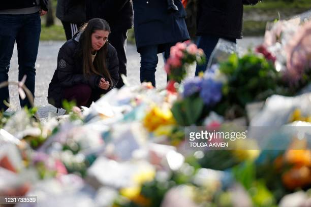 Well-wisher pauses at the tributes in honour of Sarah Everard, the missing woman who's remains were found in woodland in Kent, at the bandstand on...