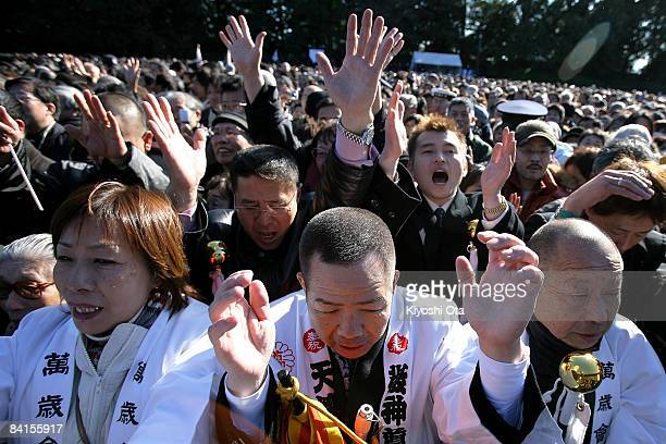 Wellwishers cheer Emperor Akihito as they celebrate the New Year at the Imperial Palace on January 2 2009 in Tokyo Japan About 52000 people visited...