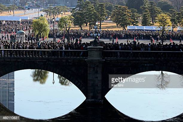 Wellwishers cross the Double Bridge as they walk towards the Imperial Palace to listen to an address by Emperor Akihito and greet the Japanese Royal...