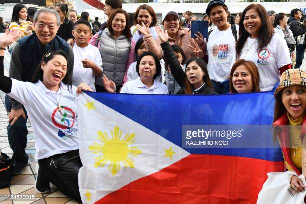 Wellwishers from the Philippines gather outside the Tokyo Dome stadium ahead of a holy mass led by Pope Francis in Tokyo on November 25 2019 Pope...