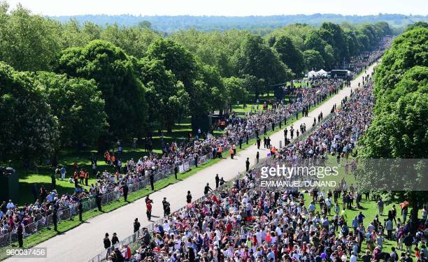 Well-wishers gather along the Long Walk leading to Windsor Castle ahead of the wedding and carriage procession of Britain's Prince Harry, Duke of...
