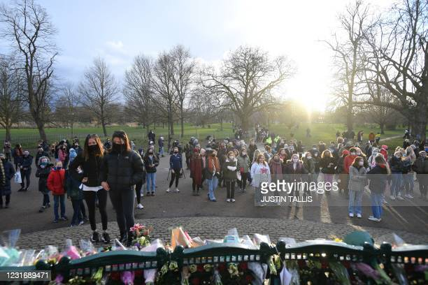 Well-wishers gather at a band-stand where a planned vigil in honour of alleged murder victim Sarah Everard was cancelled after police outlawed it due...