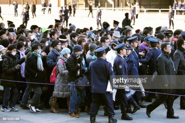 Wellwishers gather to celebrate Emperor Akihito's 84th birthday at the Imperial Palace on December 23 2017 in Tokyo Japan