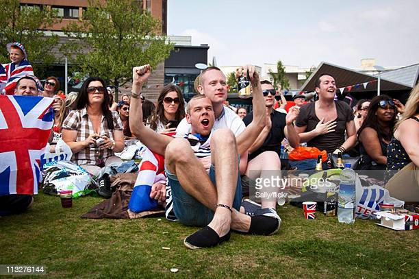 Wellwishers gather to watch the Royal Wedding of Prince William to Catherine Middleton on April 29 2011 in Liverpool England The marriage of the...