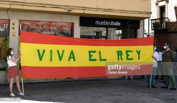 Wellwishers hold a banner which reads Long Live the King as King Felipe of Spain and Queen Letizia of Spain visit Antonio Machado Secondary School on...