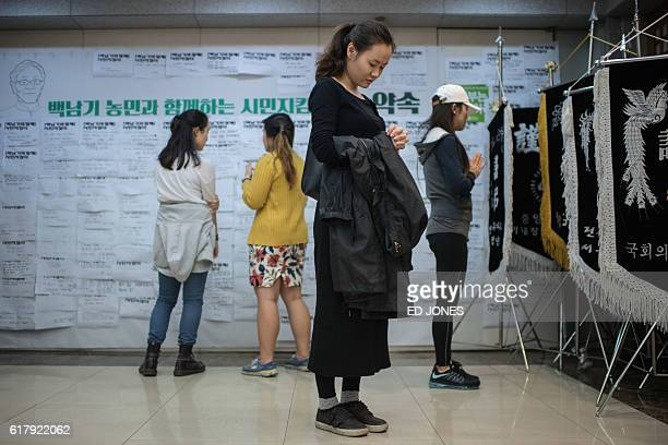 Well-wishers hold a vigil at Seoul National University Hospital as protesters attempt to stop police from retrieving the body of Baek Nam Ki for...