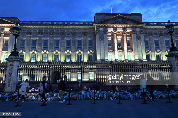 Well-wishers lay floral tributes outside Buckingham Palace in central London on April 9, 2021 after the announcement of the death of Britain's Prince...