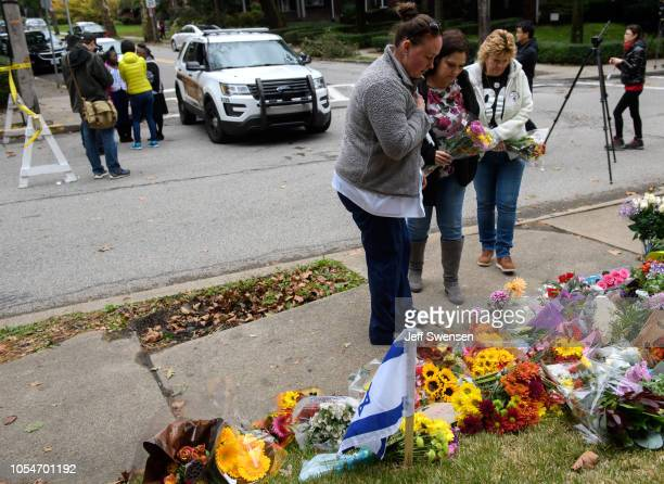 Wellwishers lay flowers at the site of the mass shooting that killed 11 people and wounded 6 at the Tree Of Life Synagogue on October 28 2018 in...