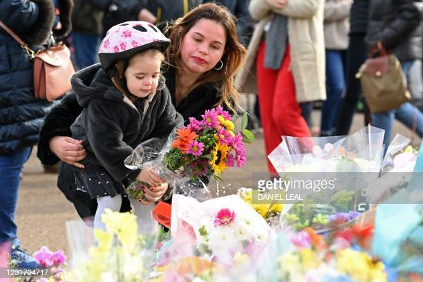Well-wishers lay flowers to honour alleged murder victim Sarah Everard at the bandstand on Clapham Common in south London on March 14 a day after...