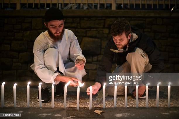 Wellwishers light 49 candles as they pay respects to victims outside the hospital in Christchurch on March 16 after a shooting incident at two...