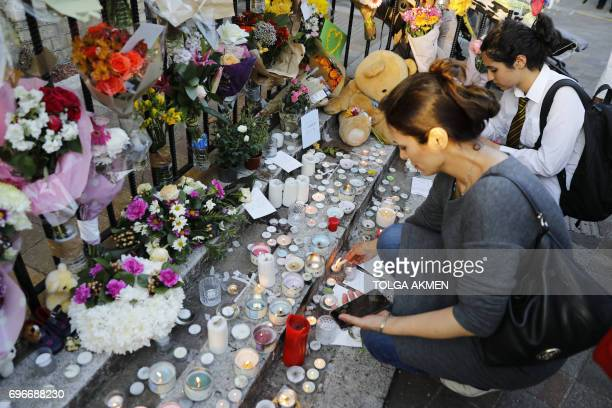 Wellwishers light candles for those who died in the fire that gutted Grenfell Tower a residential tower block in west London on June 14 Dozens of...