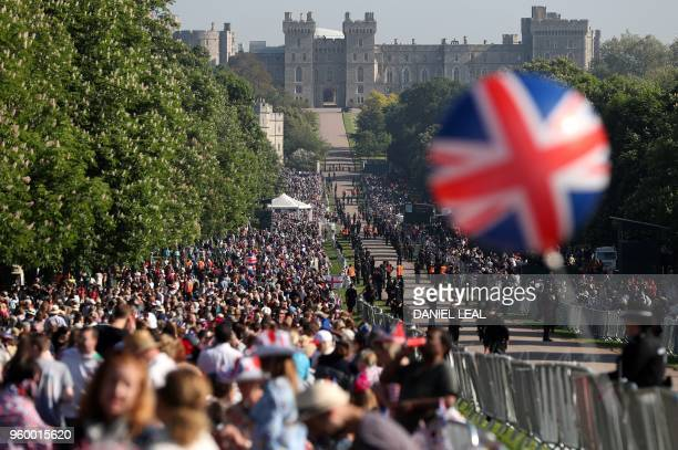 TOPSHOT Wellwishers line the Long Walk leading to Windsor Castle ahead of the wedding and carriage procession of Britain's Prince Harry and Meghan...