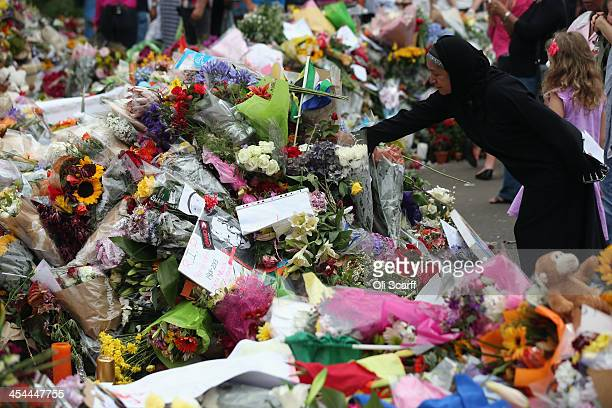 Wellwishers pay their respects outside the Houghton home of the former South African President Nelson Mandela on December 9 2013 in Johannesburg...