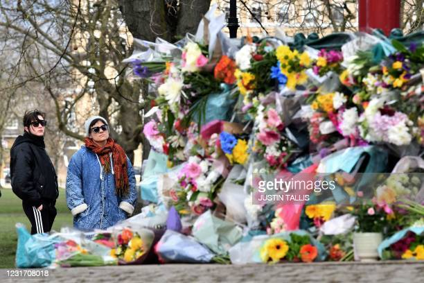 Well-wishers place flowers at a band-stand where a planned vigil in honour of murder victim Sarah Everard was cancelled after police outlawed it due...
