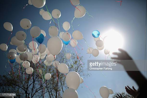 Wellwishers release balloons into the air in honour of Nelson Mandela outside the Mediclinic Heart Hospital where he is being treated on June 28 2013...