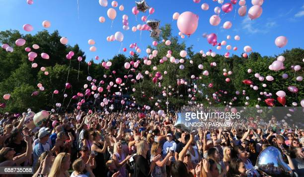 Well-wishers release thousands of balloons into the sky during a vigil to commemorate the victims of the May 22 attack on Manchester Arena at Tandle...