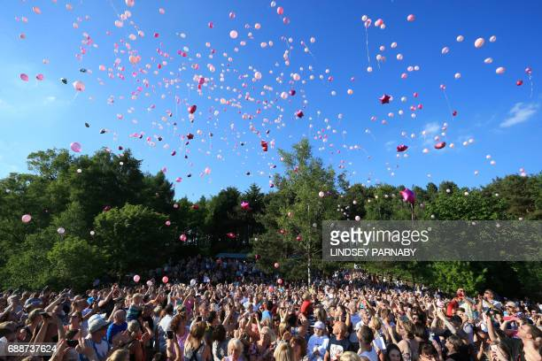 TOPSHOT Wellwishers release thousands of balloons into the sky during a vigil to commemorate the victims of the May 22 attack on Manchester Arena at...