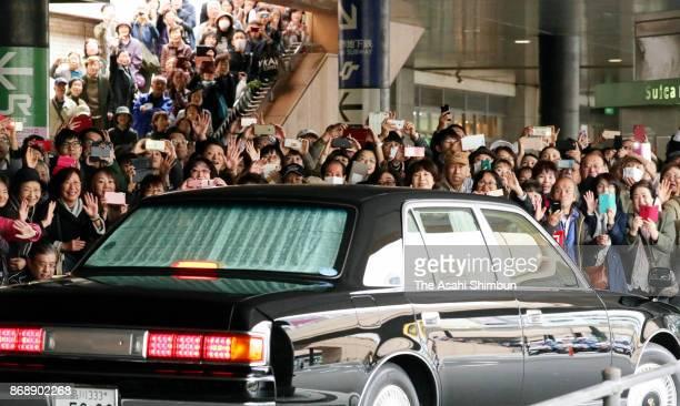 Wellwishers take photographs as Crown Prince Naruhito and Crown Princess Masako depart at JR Sendai Station on November 1 2017 in Sendai Miyagi Japan...