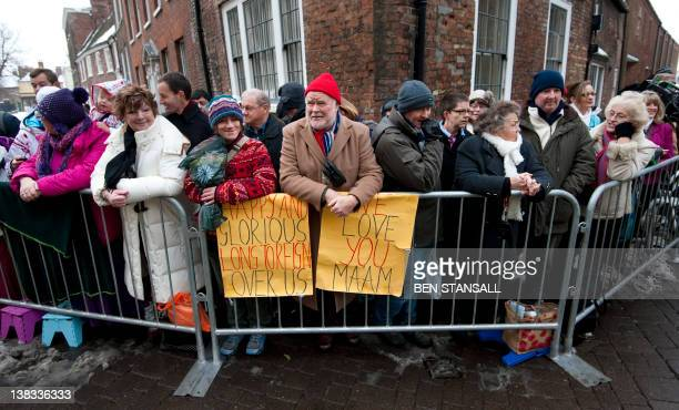 Wellwishers wait behind a barrier to greet Britain's Queen Elizabeth II during a vist to Kings Lynn Town Hall in Kings Lynn Norfolk on February 6...