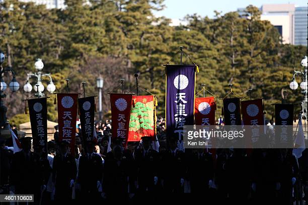 Wellwishers walk through the gate of the Imperial Palace to listen to an address by Emperor Akihito and greet the Japanese Royal Family during...