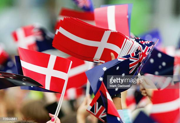 Wellwishers wave Danish and Australian flags during the visit of Crown Prince Frederick and Crown Princess Mary of Denmark to Federation Square on...