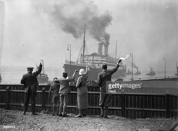 Well-wishers wave goodbye to Douglas Jardine and the other members of the MCC as they set sail from Tilbury to Australia on the Orient liner Orontes.