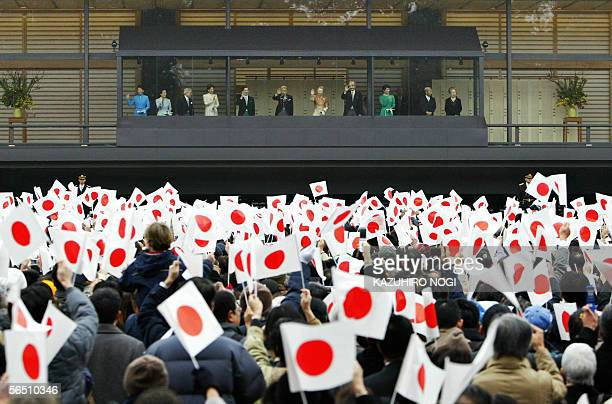 Wellwishers wave national flags to the imperial family during the annual New Year's greeting at the Imperial Palace in Tokyo 02 January 2006 Emperor...