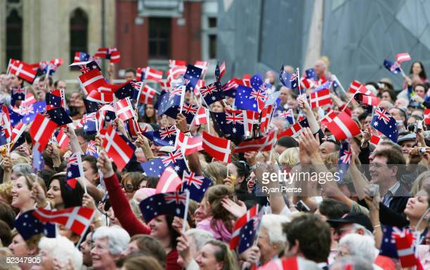 Wellwishers wave their flags to greet Crown Prince Frederik and Crown Princess Mary of Denmark during their visit to Federation Square on March 10...