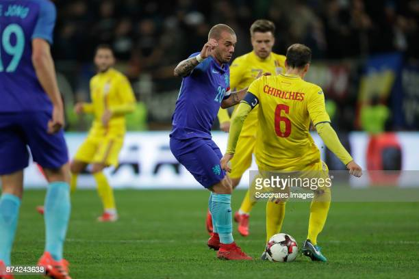 Welsey Sneijder of Holland Vlad Chiriches of Romania during the International Friendly match between Romania v Holland at the Arena Nationala on...