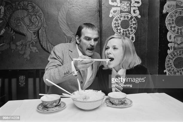 Welsh actor and film producer Stanley Baker eating at Young's Chinese restaurant with English actress Honor Blackman during a photocall for their new...