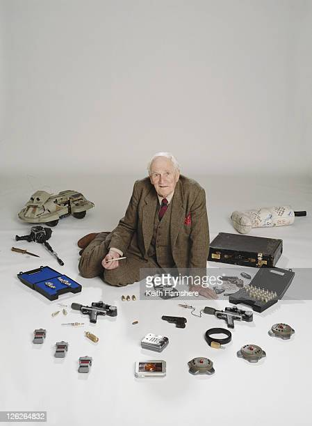 Welsh actor Desmond Llewelyn as Q surrounded by his gadgets in a publicity still for the James Bond 'GoldenEye' 1995 Amongst them are the GoldenEye...
