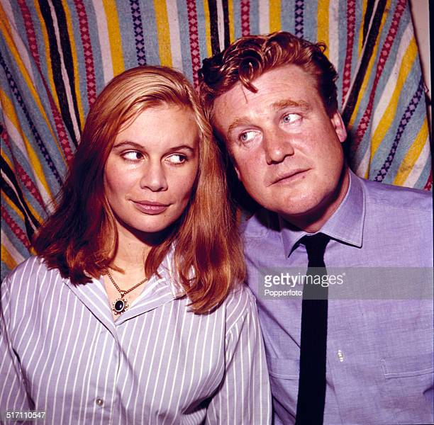 Welsh actor Donald Houston posed with English actress Joanna Dunham on the set of the television drama 'Love Story Commutors' in 1964