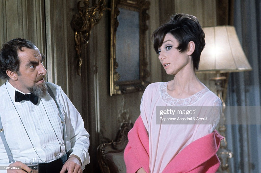 Welsh actor Hugh Griffith looking at British actress Audrey Hepburn (Audrey Kathleen Ruston) in the film How to Steal a Million. 1966