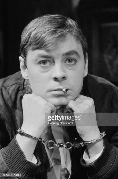 Welsh actor Hywel Bennett handcuffed while rehearsing for the play 'Night Must Fall', Shaw Theatre, London, March 19th 1975.